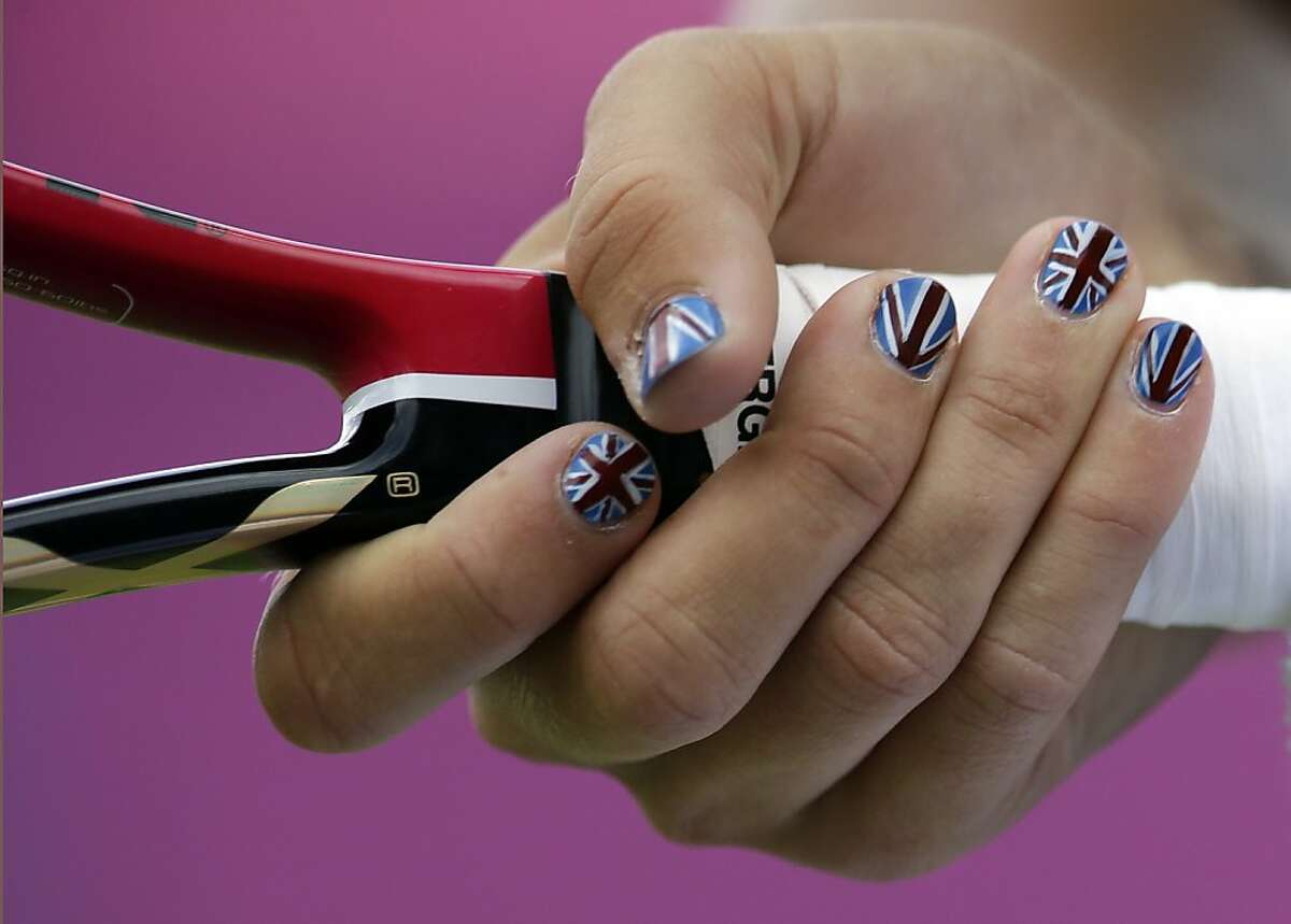 The nails of Laura Robson of Great Britain are painted with colors of the Union Flag as she plays against Lucie Safarova at the All England Lawn Tennis Club at Wimbledon, in London, at the 2012 Summer Olympics, Monday, July 30, 2012. (AP Photo/Mark Humphrey)
