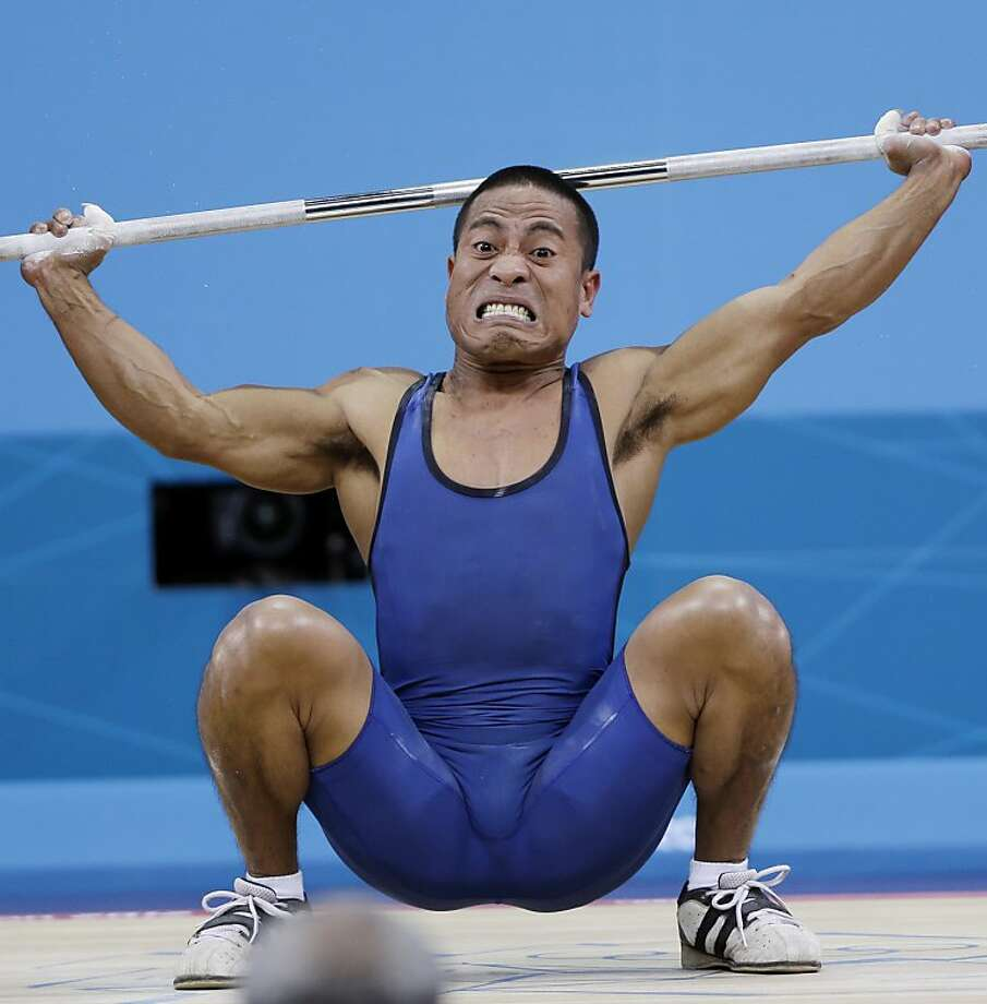 Manuel Minginfel off Micronesia competes during the mens 62-kg weightlifting competition at the 2012 Summer Olympics, Monday, July 30, 2012, in London. (AP Photo/Mike Groll) Photo: Mike Groll, Associated Press