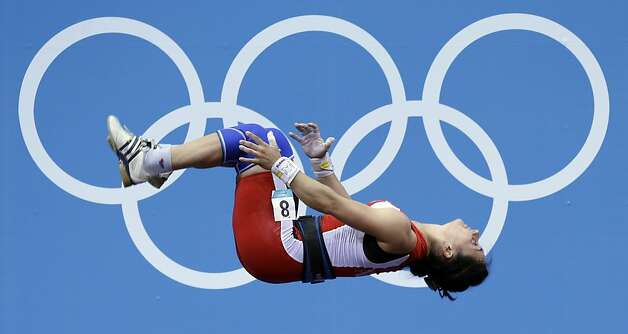 Romela Begaj of Albania does a back flip after competing during the women's 58-kg, group A, weightlifting competition at the 2012 Summer Olympics, Monday, July 30, 2012, in London. (AP Photo/Hassan Ammar) Photo: Hassan Ammar, Associated Press