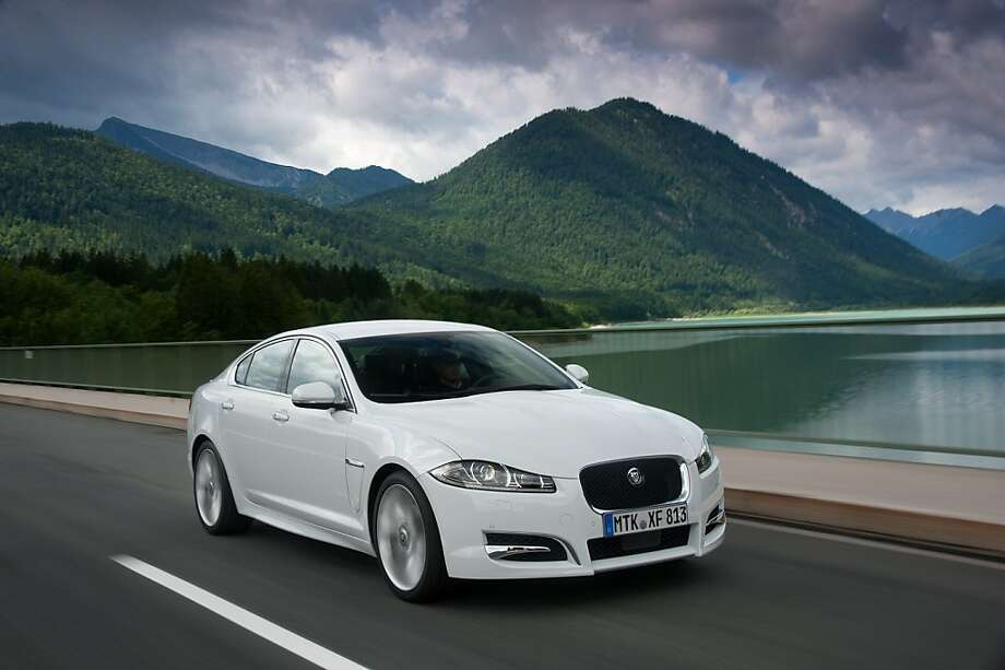 The 2012 Jaguar XF Diesel Sedan still has classic looks, including its interior, below, but includes more contemporary design elements, competing with BMW's 5 Series and the Infiniti M56. Photo: Jaguar