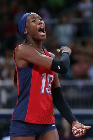 Destinee Hooker lets out a yell as she rejoices after the United States won a point in its preliminary match against Brazil. The Southwest High graduate accounted for 23 points. (Elsa / Getty Images)