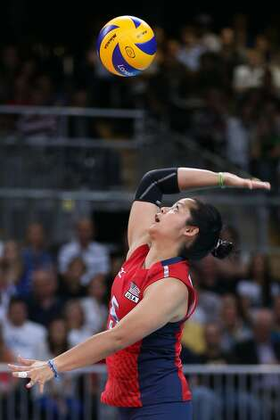 Tamari Miyashiro of United States serves in the Women's Volleyball Preliminary match between the United States and Brazil on Day 3 of the London 2012 Olympic Games at Earls Court on July 30, 2012 in London, England. (Elsa / Getty Images)
