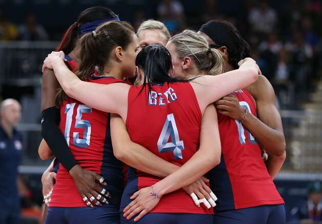 The United States form a huddle in the Women's Volleyball Preliminary match between the United States and Brazil on Day 3 of the London 2012 Olympic Games at Earls Court on July 30, 2012 in London, England. (Elsa / Getty Images)
