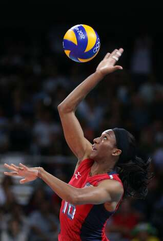 Foluke Akinradewo of United States serves in the Women's Volleyball Preliminary match between the United States and Brazil on Day 3 of the London 2012 Olympic Games at Earls Court on July 30, 2012 in London, England. (Elsa / Getty Images)