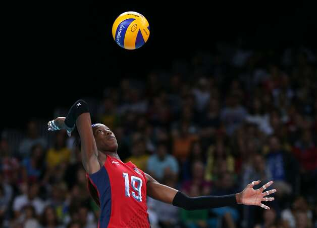 Destinee Hooker of the United States prepares to serve the ball against Brazil in preliminary pool play. The Americans won 25-18, 25-17, 22-25, 25-21. (Elsa / Getty Images)
