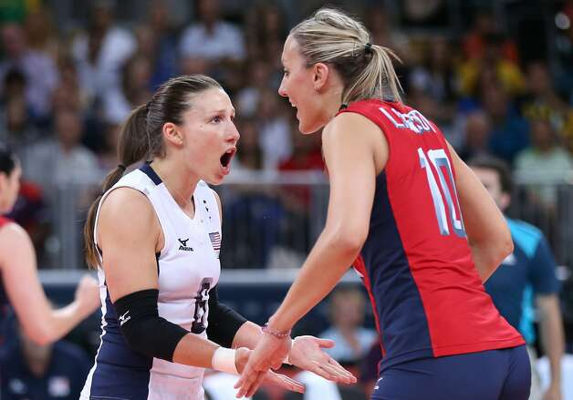 Nicole Davis of United States celebrates a point with team mate Jordan Larson in the Women's Volleyball Preliminary match between the United States and Brazil on Day 3 of the London 2012 Olympic Games at Earls Court on July 30, 2012 in London, England. (Elsa / Getty Images)