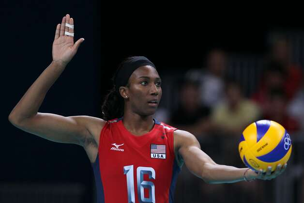 Foluke Akinradewo of United States prepares to serve in the Women's Volleyball Preliminary match between the United States and Brazil on Day 3 of the London 2012 Olympic Games at Earls Court on July 30, 2012 in London, England. (Elsa / Getty Images)