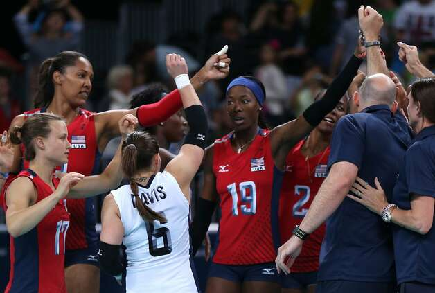 The United States player celebrate winning the Women's Volleyball Preliminary match between the United States and Brazil on Day 3 of the London 2012 Olympic Games at Earls Court on July 30, 2012 in London, England. (Elsa / Getty Images)