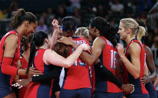 The United States player celebrate winning the Women's Volleyball Preliminary match between the United States and Brazil on Day 3 of the London 2012 Olympic Games at Earls Court on July 30, 2012 in London, England. Photo: Elsa, Getty Images / 2012 Getty Images