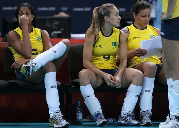 Fernanda Ferreira of Brazil and team mate Adenizia Silva look on after losing the Women's Volleyball Preliminary match between the United States and Brazil on Day 3 of the London 2012 Olympic Games at Earls Court on July 30, 2012 in London, England. (Elsa / Getty Images)