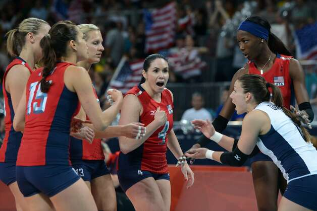 US players celebrate winning a point during the women's preliminary pool B volleyball match between the US and Brazil in the 2012 London Olympic Games in London on July 30, 2012. (KIRILL KUDRYAVTSEV / AFP/Getty Images)