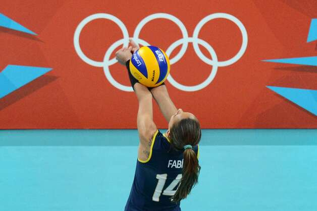 Brazil's Fabiana Oliveira attempts to set during the women's preliminary pool B volleyball match between USA and Brazil during the 2012 London Olympic Games in London on July 30, 2012. (KIRILL KUDRYAVTSEV / AFP/Getty Images)