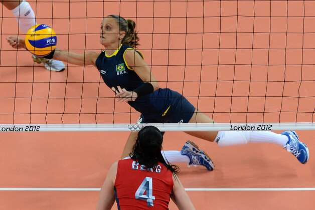 Brazil's Fabiana Oliveira attempts to set the ball during the women's preliminary pool B volleyball match between the US and Brazil in the 2012 London Olympic Games in London on July 30, 2012. (KIRILL KUDRYAVTSEV / AFP/Getty Images)