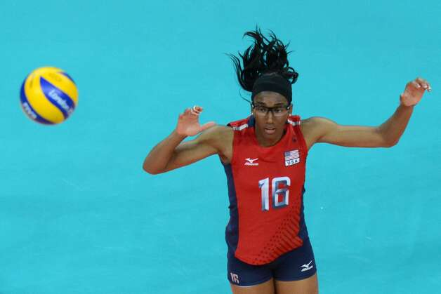 US player Foluke Akinradewo attempts to spike the ball during the women's preliminary pool B volleyball match between the US and Brazil in the 2012 London Olympic Games in London on July 30, 2012. (KIRILL KUDRYAVTSEV / AFP/Getty Images)