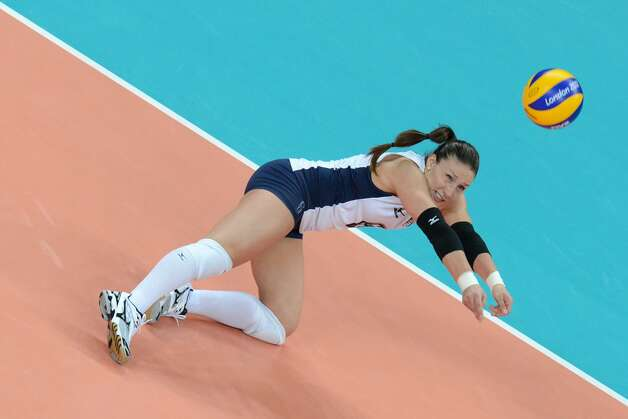US player Nicole Davis attempts to set the ball during the women's preliminary pool B volleyball match between the US and Brazil in the 2012 London Olympic Games in London on July 30, 2012. (KIRILL KUDRYAVTSEV / AFP/Getty Images)