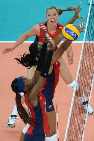US player Jordan Larson (top) reacts during the women's preliminary pool B volleyball match between the US and Brazil in the 2012 London Olympic Games in London on July 30, 2012. (KIRILL KUDRYAVTSEV / AFP/Getty Images)