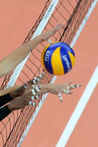 US players attempt to block during the women's preliminary pool B volleyball match between the US and Brazil in the 2012 London Olympic Games in London on July 30, 2012. (KIRILL KUDRYAVTSEV / AFP/Getty Images)