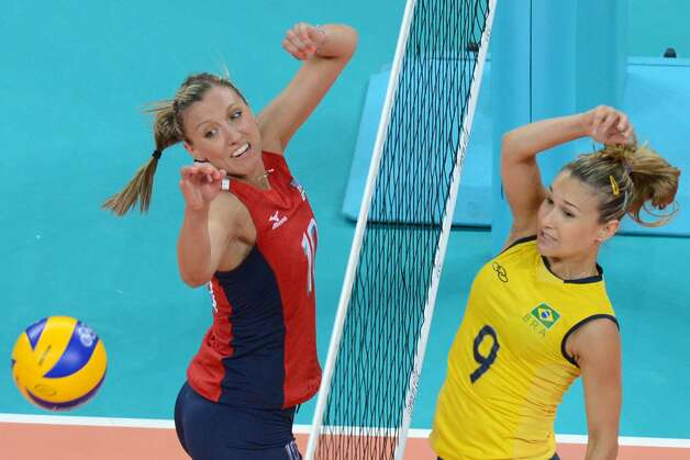 Brazil's Fernanda Ferreira (R) spikes the ball as US player Jordan Larson attempts to block during the women's preliminary pool B volleyball match between the US and Brazil in the 2012 London Olympic Games in London on July 30, 2012. (KIRILL KUDRYAVTSEV / AFP/Getty Images)