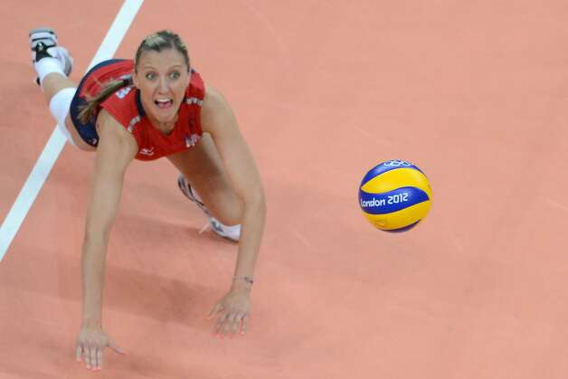 US player Jordan Larson attempts to set the ball during the women's preliminary pool B volleyball match between the US and Brazil in the 2012 London Olympic Games in London on July 30, 2012. (KIRILL KUDRYAVTSEV / AFP/Getty Images)