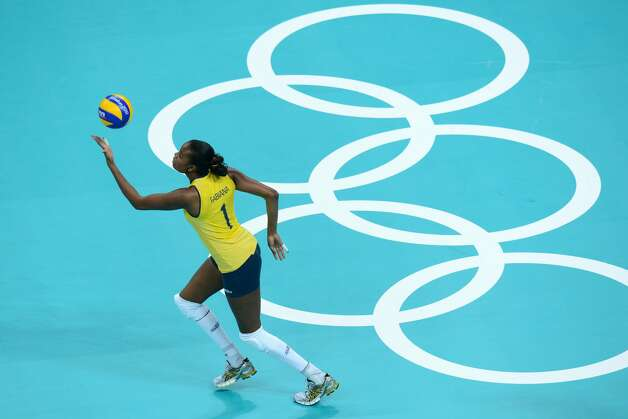 Brazil's Fabiana Claudino serves during the women's preliminary pool B volleyball match between USA and Brazil during the 2012 London Olympic Games in London on July 30, 2012. (KIRILL KUDRYAVTSEV / AFP/Getty Images)