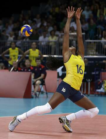 Brazil's Fernanda Rodrigues cannot reach a ball as it falls in for a United States point during a women's preliminary volleyball match at the 2012 Summer Olympics, Monday, July 30, 2012, in London. (Jeff Roberson / Associated Press)