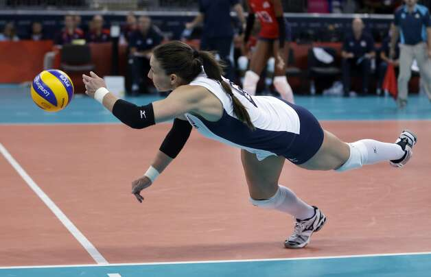United States' Nicole Davis tries to keep a ball alive during a women's preliminary volleyball match against Brazil at the 2012 Summer Olympics, Monday, July 30, 2012, in London. (Jeff Roberson / Associated Press)