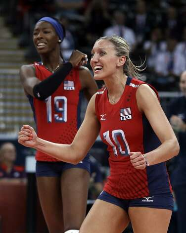 United States' Destinee Hooker, left, and teammate Jordan Larson celebrate during a women's preliminary volleyball match against Brazil at the 2012 Summer Olympics, Monday, July 30, 2012, in London. (Jeff Roberson / Associated Press)