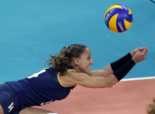 Brazil's Fabiana Oliveira reaches for the ball during a women's preliminary volleyball match against the United States at the 2012 Summer Olympics, Monday, July 30, 2012, in London. (Jeff Roberson / Associated Press)