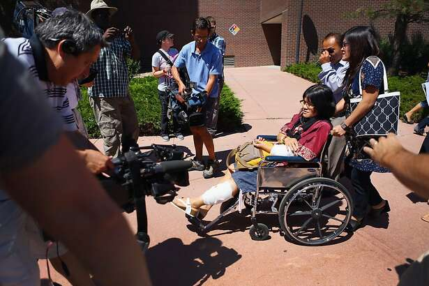 CENTENNIAL, CO - JULY 30:  Rita Paulina who was wounded during the shooting at the screening of The Dark Knight Rises leaves in a wheelchair with her family from the Arapahoe County Courthouse after attending an arraignment hearing for suspect James Holmes on July 30, 2012 in Centennial, Colorado. James Holmes, 24, who is accused of killing 12 people and injuring 58 in a shooting spree July 20, during a screening of 'The Dark Knight Rises.' in Aurora, Colorado was charged with 24 counts of first-degree murder and 116 counts of attempted murder.  (Photo by Joe Raedle/Getty Images)