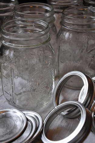 Glass jars ready to can the over-abudance of the season's bounty. Photo: Contributed Photo / Fairfield Citizen contributed