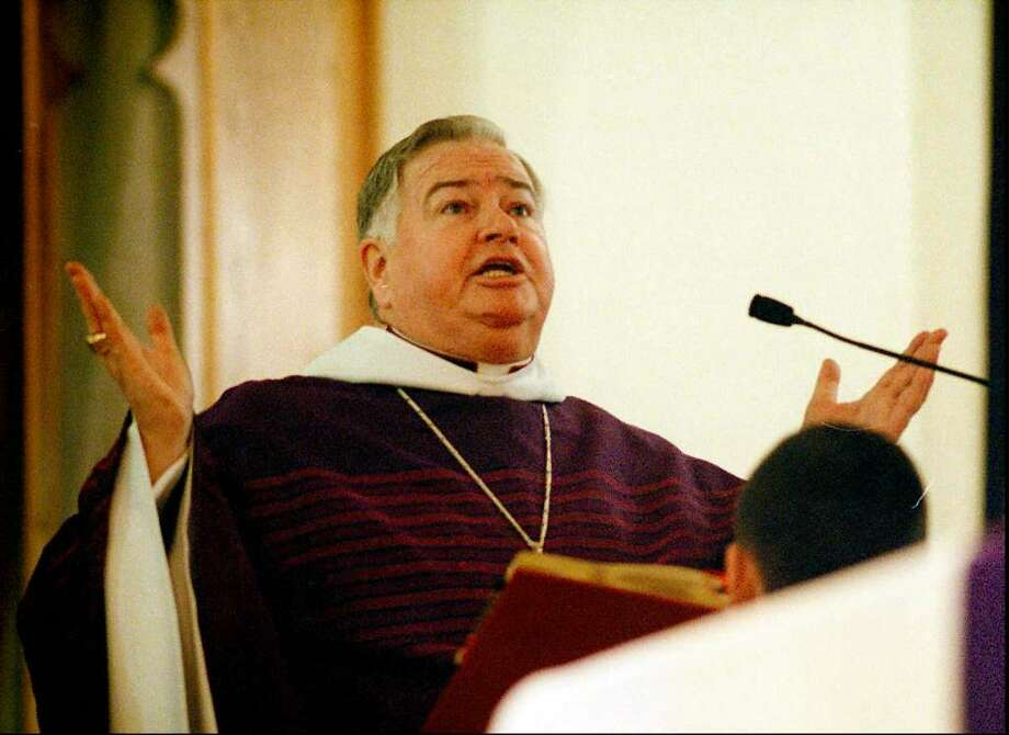 Charles Stubbs, former Pastor at St. Mary's, said his farewell Mass on Sunday, Feb. 23, 1997. Photo: Staff File Photo
