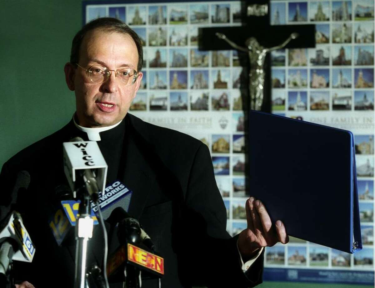 Bishop Lori speaks during a press conference at the Catholic Center in Bridgeport on October 16, 2003