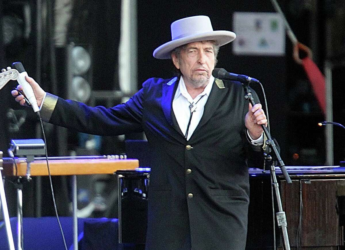 """FILE - This July 22, 2012 file photo shows U.S. singer-songwriter Bob Dylan performing on at """"Les Vieilles Charrues"""" Festival in Carhaix, western France. A staff writer for The New Yorker has resigned and his latest book has been halted after he acknowledged inventing quotes by Bob Dylan. Jonah Lehrer released a statement Monday, July 30, through his publisher, Houghton Mifflin Harcourt, that some Dylan quotes appearing in his book """"Imagine: How Creativity Works"""" did """"not exist."""" Others were """"unintentional misquotations, or represented improper combinations of previously existing quotes."""" (AP Photo/David Vincent, file)"""