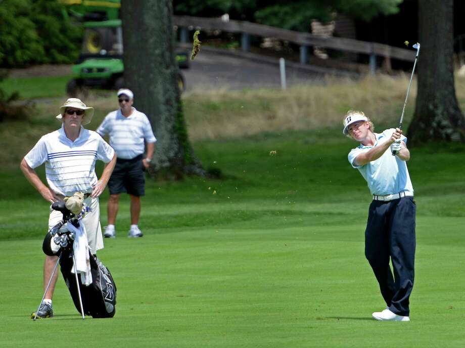 Tommy McDonagh of East Norwalk hitting from the fairway on the 9th hole at the78th Connecticut Open golf Championship played at Wee Burn Country Club, Darien, CT on Monday July 30th, 2012. Photo: Mark Conrad / Stamford Advocate Freelance