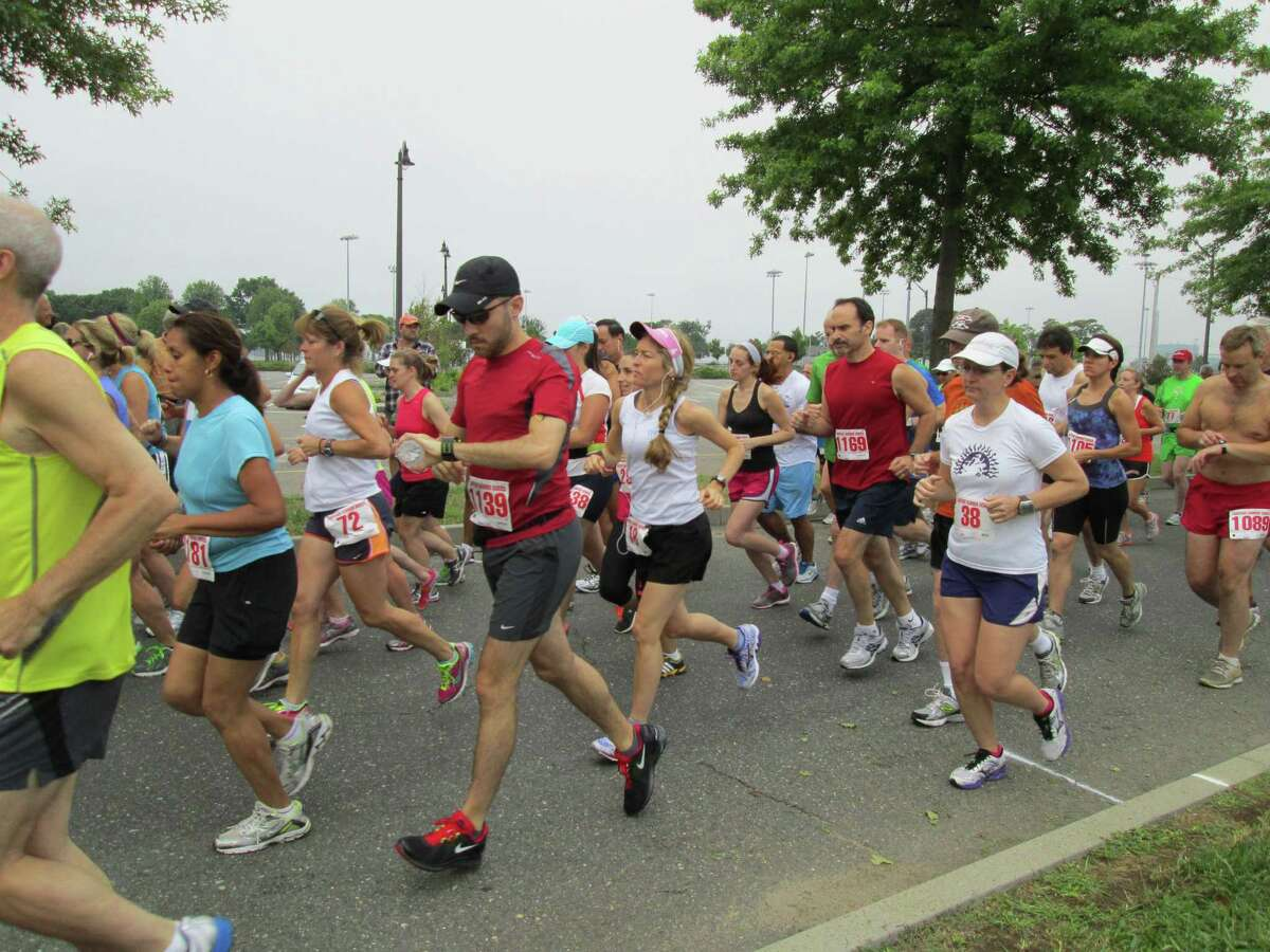 Runners compete in the Lightfoot Running Club's 14th annual Ian James Eaccarino Memorial 9-miler at Calf Pasture Beach in Norwalk on Saturday.