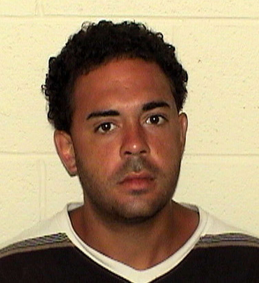 Alexander Rosario failed to show up in Superior Court in Derby on Monday July 30, 2012. Rosario, 32, of Washington Avenue, Bridgeport was arrested earlier this month after he allegedly tried to toss a dog off a bridge and onto Route 8. Photo: Contributed Photo / Connecticut Post Contributed