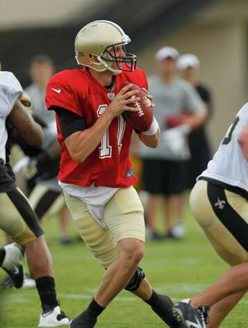 New Orleans Saints quarterback Luke McCown (11)  drops back to pass during training camp at their NFL football training facility in Metairie, La., Saturday, July 28, 2012. (AP Photo/Gerald Herbert) Photo: Gerald Herbert, STF / AP