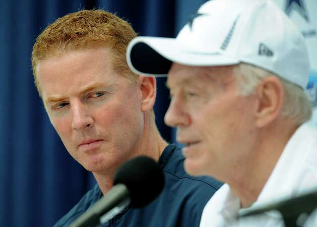 Dallas Cowboys head coach Jason Garrett, left, watches as owner Jerry Jones answers a question during a news conference at NFL football training camp, Sunday, July 29, 2012, in Oxnard, Calif. (AP Photo/Gus Ruelas) Photo: GUS RUELAS, FRE / FR157633 AP
