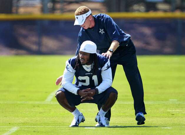 Dallas Cowboys defensive back Mike Jenkins (21) gets a pat on the shoulder from head coach Jason Garrett during Cowboys training camp, Monday, July 30, 2012, in Oxnard, California. (Ron Jenkins/Fort Worth Star-Telegram/MCT) Photo: Ron Jenkins, MBR / Fort Worth Star-Telegram