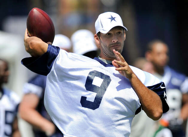 Dallas Cowboys quarterback Tony Romo passes the ball during NFL training camp, Monday, July 30, 2012, in Oxnard, Calif. (AP Photo/Gus Ruelas) Photo: Gus Ruelas, FRE / FR157633 AP