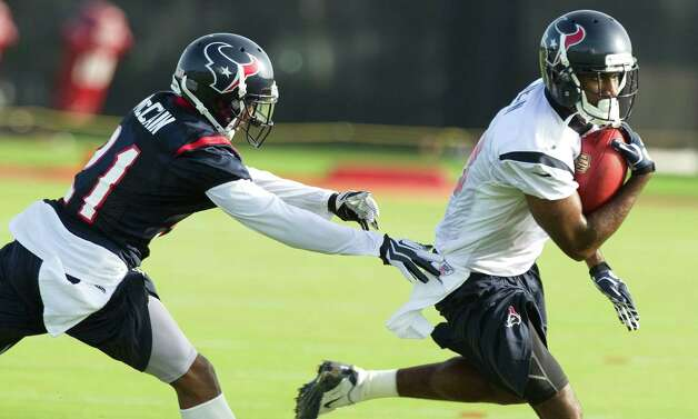 Houston Texans cornerback Brice McCain (21) chases down wide receiver Lestar Jean (18) after Jean made a catch during Texans training camp at the Methodist Training Center Saturday, July 28, 2012, in Houston.  ( Brett Coomer / Houston Chronicle ) Photo: Brett Coomer, Staff / © 2012 Houston Chronicle