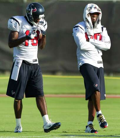 Houston Texans wide receivers Lestar Jean (18) and Andre Johnson (80) stand of the field during Texans training camp at the Methodist Training Center Monday, July 30, 2012, in Houston. Johnson sat out Monday's practice with a strained groin. ( Brett Coomer / Houston Chronicle ) Photo: Brett Coomer, Staff / © 2012 Houston Chronicle