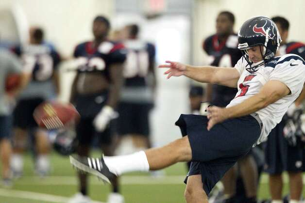 Houston Texans punter Donnie Jones (5) punts the ball during Texans training camp at the Methodist Training Center Monday, July 30, 2012, in Houston.  ( Brett Coomer / Houston Chronicle ) Photo: Brett Coomer, Staff / © 2012 Houston Chronicle