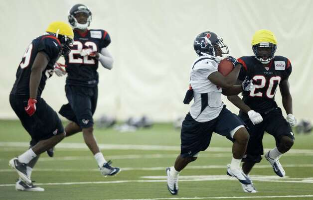 Houston Texans wide receiver Trindon Holliday runs past cornerback Roc Carmichael (20) as he returns a punt during Texans training camp at the Methodist Training Center Monday, July 30, 2012, in Houston.  ( Brett Coomer / Houston Chronicle ) Photo: Brett Coomer, Staff / © 2012 Houston Chronicle