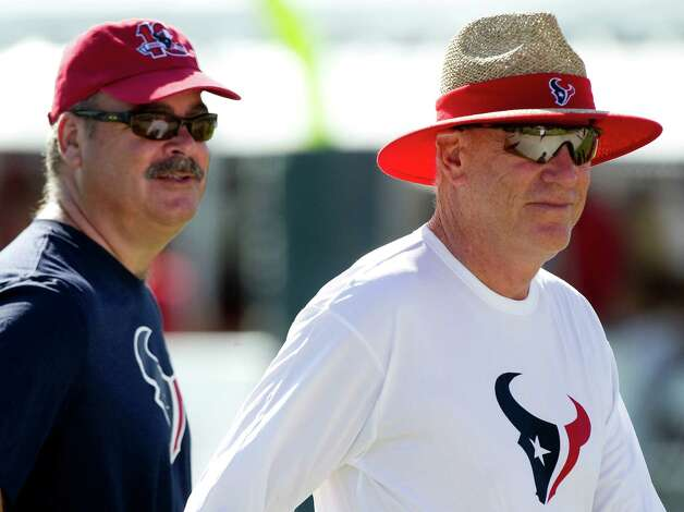 Cal McNair, left, vice chairman and COO of the Houston Texans, left, and his father, team owner Bob McNair walk off the field at the end of practice during Texans training camp at the Methodist Training Center Monday, July 30, 2012, in Houston.  ( Brett Coomer / Houston Chronicle ) Photo: Brett Coomer, Staff / © 2012 Houston Chronicle