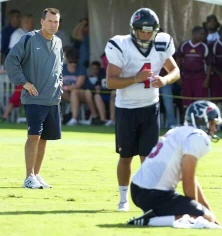 Houston Texans head coach Gary Kubiak, left, looks on as kicker Randy Bullock (4) lines up to kick a field goal during Texans training camp at the Methodist Training Center Monday, July 30, 2012, in Houston.  ( Brett Coomer / Houston Chronicle ) Photo: Brett Coomer, Staff / © 2012 Houston Chronicle