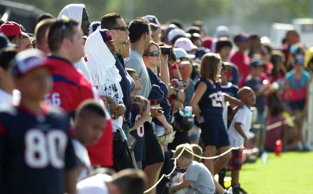 Houston Texans fans line the field to watch practice during Texans training camp at the Methodist Training Center Monday, July 30, 2012, in Houston.  ( Brett Coomer / Houston Chronicle ) Photo: Brett Coomer, Staff / © 2012 Houston Chronicle