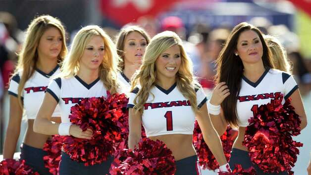 Houston Texans cheerleaders walk amongst the fans during Texans training camp at the Methodist Training Center Monday, July 30, 2012, in Houston.  ( Brett Coomer / Houston Chronicle ) Photo: Brett Coomer, Staff / © 2012 Houston Chronicle