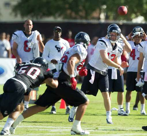 Houston Texans quarterback T.J. Yates (13) throws a pass to tight end James Casey during Texans training camp at the Methodist Training Center Monday, July 30, 2012, in Houston.  ( Brett Coomer / Houston Chronicle ) Photo: Brett Coomer, Staff / © 2012 Houston Chronicle
