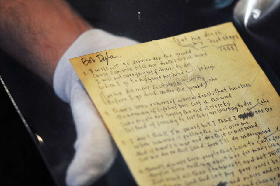 Bob Dylan's hand written lyrics for 'Let me die in my footsteps.' was among a vast array of memorabilia up for auction on July 3, 2012 in London, England. (Bethany Clarke / Getty Images)
